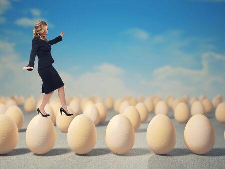 ability: caucasian businesswoman walk on 3d eggs