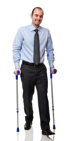 man with crutch isolated on white background Stock Photo