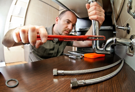 portrait of caucasian plumber at work Stock Photo - 13658730