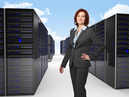 smiling businesswoman and datacenter photo