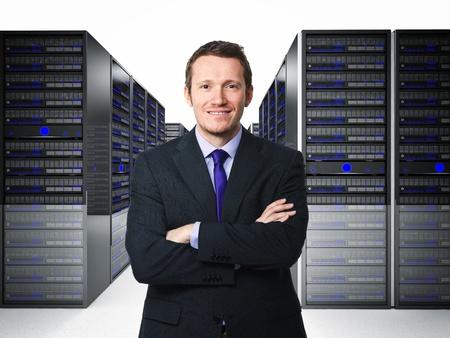 computer terminals: confident businessman in datacenter 3d