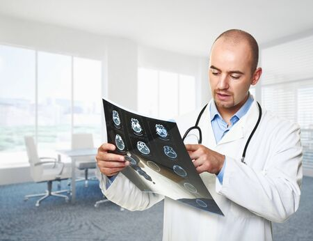 modern doctor: caucasian doctor look x-ray in office Stock Photo