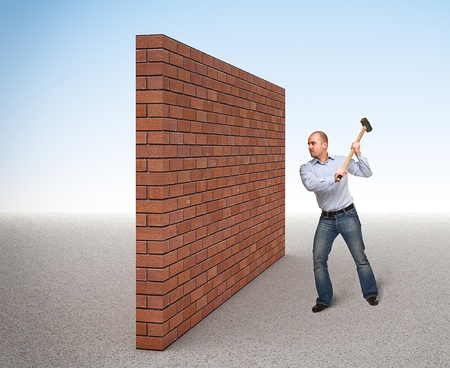 destroy: man with huge hammer and brick wall