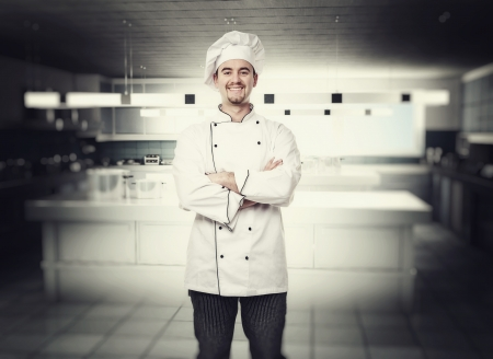 portrait of chef in modern kitchen photo