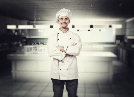 chef cocinando: Retrato del chef en la cocina moderna Foto de archivo
