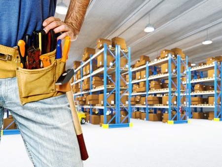 detail of tool belt and warehouse background photo