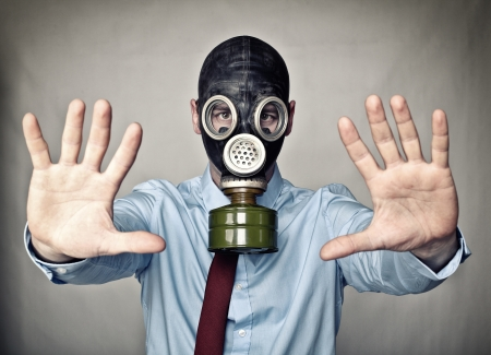 gas mask: businessman with gas mask stop posture
