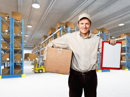 merchandise: caucasian delivery man in warehouse