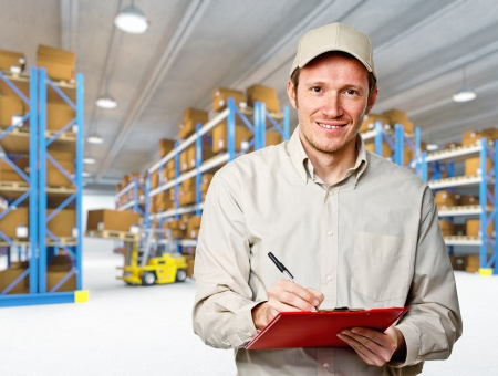 smiling worker in warehouse work place Stock Photo - 13885066
