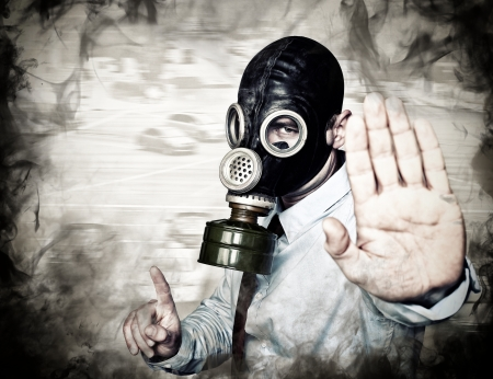 chemical hazard: businessman with gas mask in stop posture