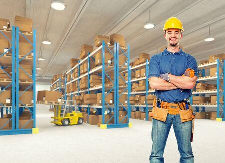 smiling handyman in classic warehouse photo