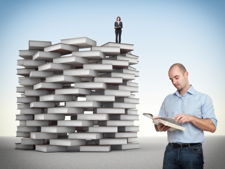 woman stairs: businesspeople and 3d book tower Stock Photo