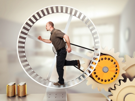 office slave: man run on hamster wheel