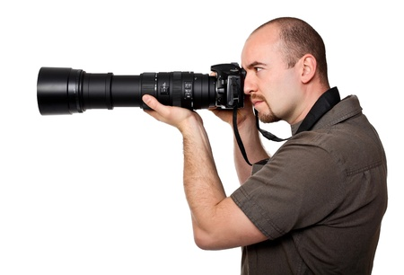 reflexes: man with camera and huge lens