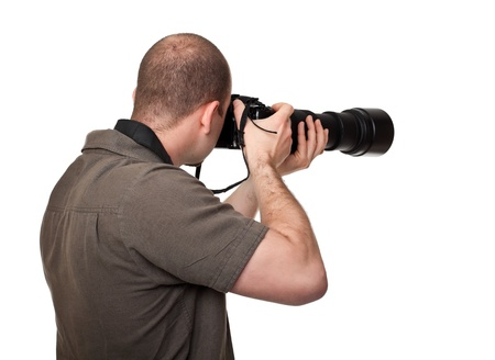 man with camera and huge lens photo