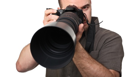 portrait of man with camera isolated on white photo