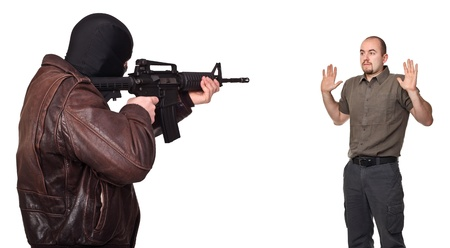 hostage: portrait of terrorist back view and young hostage