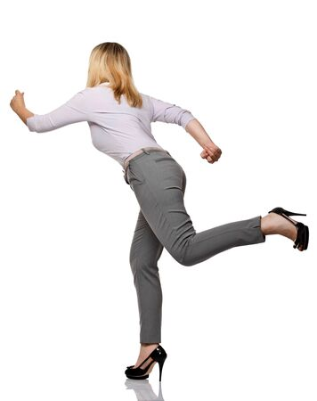 haste: running woman back view isolated on white background