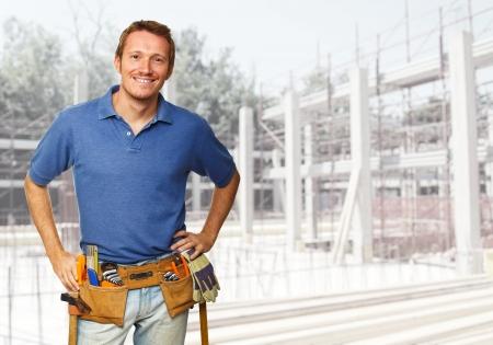 smiling handyman at construction site photo
