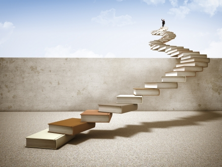 businessman on top of books stair photo