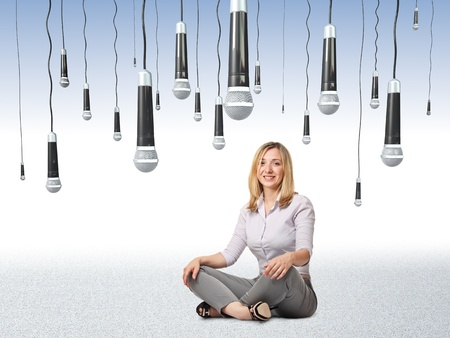 smiling sit woman and 3d microphone background Stock Photo - 14741713