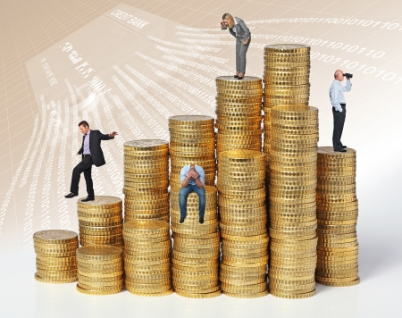 retirement money: business people on coin piles Stock Photo