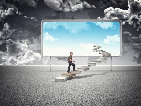 man on books steps and blue sky photo