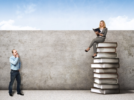 man and woman with 3d book pile background photo