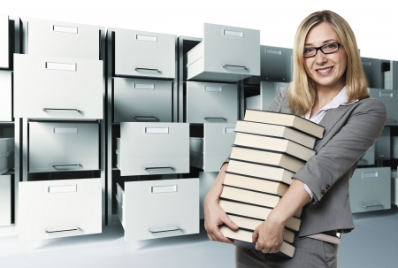 smiling woman with books and file cabinet background photo