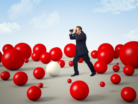 man with binoculars and 3d red balls world Stock Photo - 14903326
