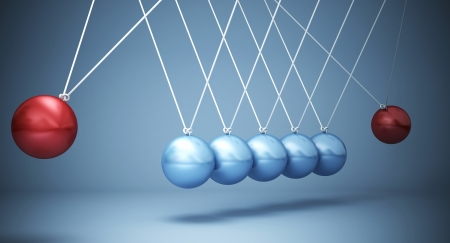 business competition: classic newton cradle with opposite power
