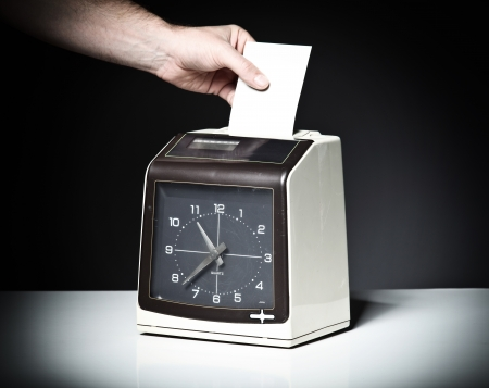 working late: image of vintage check clock Stock Photo