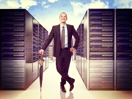 datacenter: smiling man with umbrella and 3d server background Stock Photo