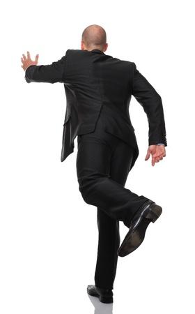 gente corriendo: hombre corriendo aislado sobre fondo blanco Foto de archivo