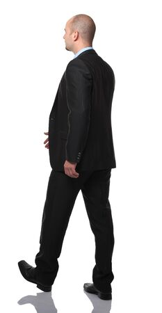 businessman walking isolated on white background photo