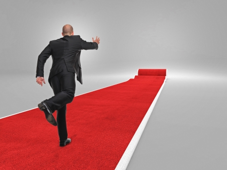 exclusive: businessman run on 3d red carpet