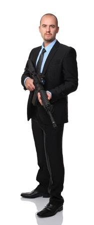 businessman with rifle isolated on white photo