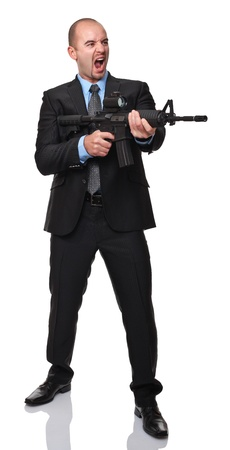 angry businessman with rifle isolated on white background photo