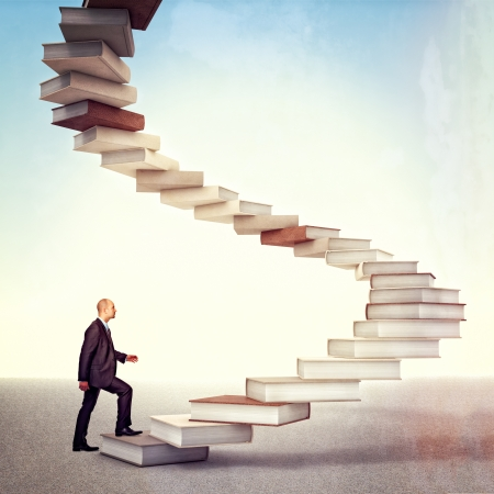 spiral staircase: young businessman go up on 3d books stair Stock Photo