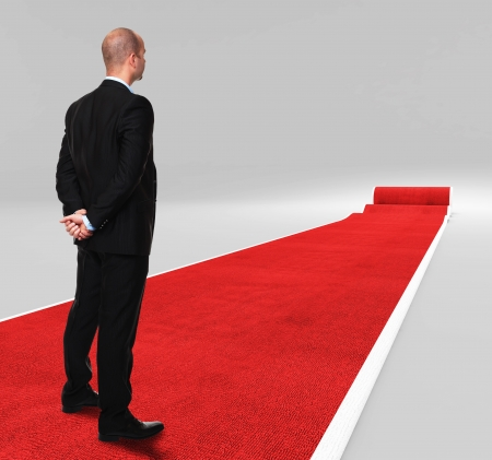 3d image of classic red carpet with standing man Stock Photo