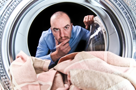 portrait of man view from washing machine inside Stock Photo - 15941521