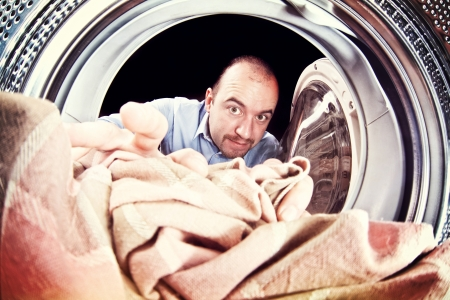 portrait of man view from washing machine inside photo