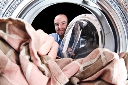 portrait of man view from washing machine inside Stock Photo - 15941518