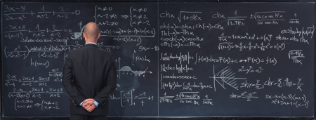 man and classic blackboard with math text