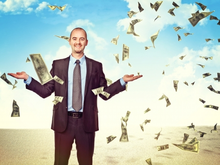 money rain: confident man and dollar rain Stock Photo