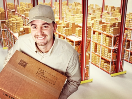 order shipment: friendly worker in classic warehouse Stock Photo