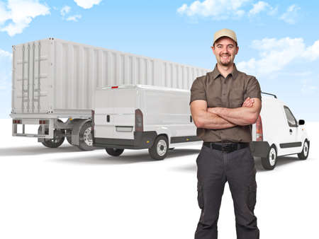 crossed arms: smiling man crossed arms and truck background Stock Photo