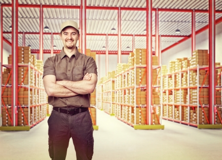 smiling delivery man in classic warehouse photo