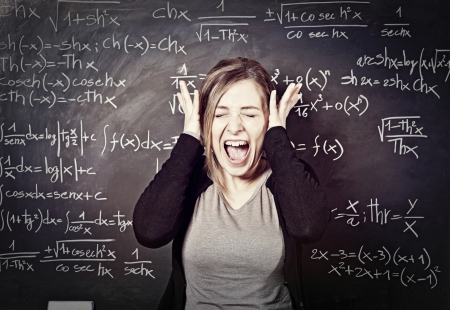 portrait of stressed teacher and blackboard background Stock Photo