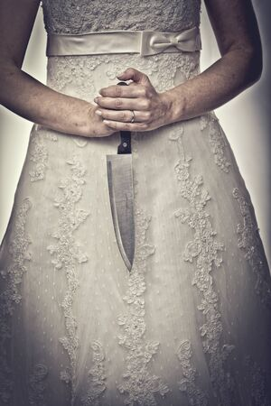 detail of bride holding sharp knife Stock Photo